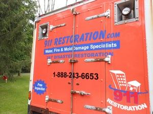 Water Damage Restoration Box Truck Rear At Residential Job Location