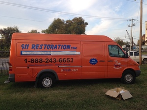 Water Damage Restoration Side Of Van At Dusk