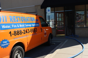 Water Damage Restoration Van Running Suction At Job Location