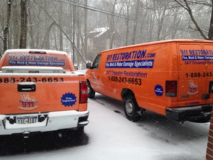 Water Damage Restoration Truck And Van At Winter Job Site